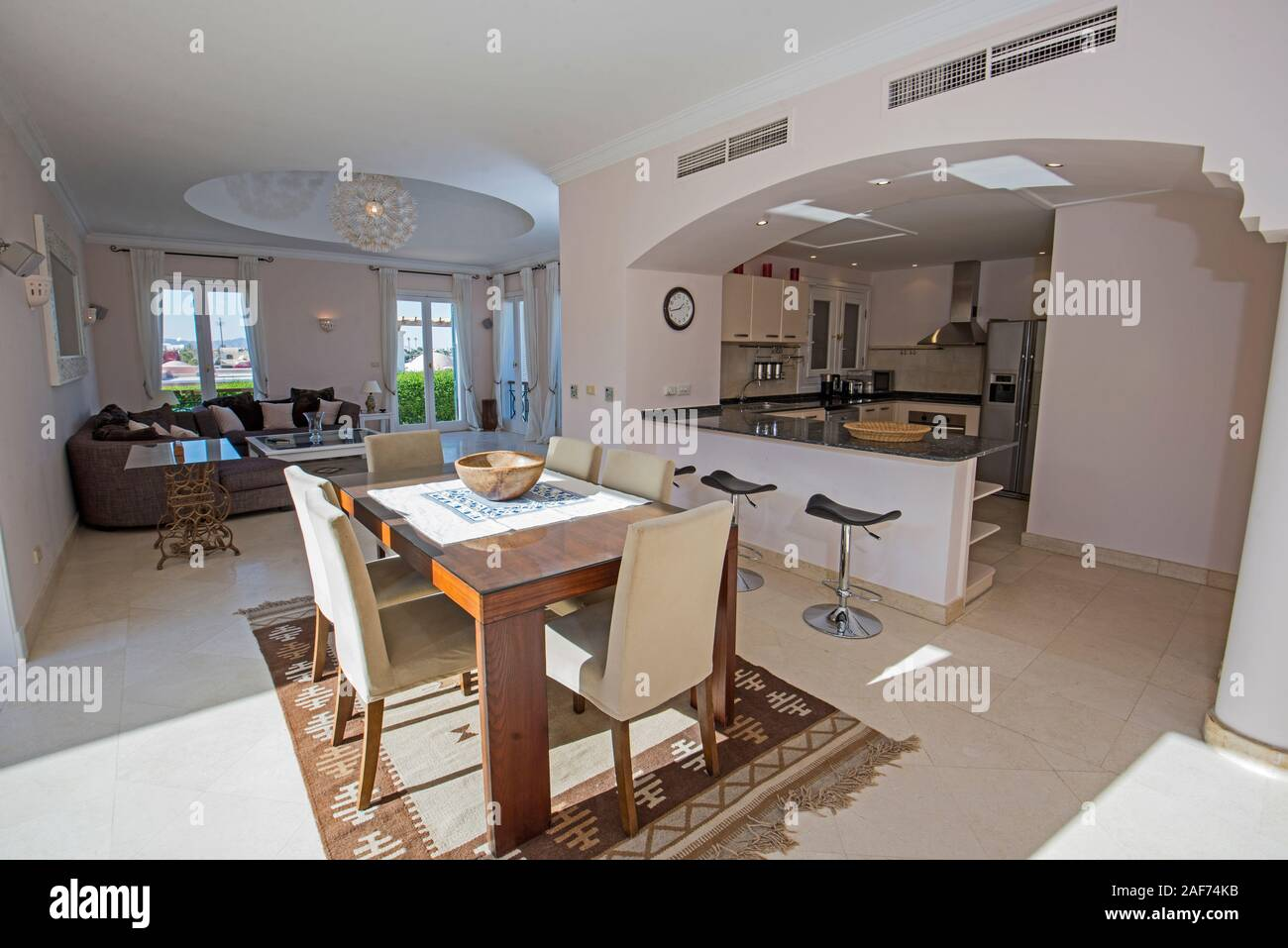 Living Room Lounge In Luxury Villa Show Home Showing Interior Design Decor Furnishing And Open Plan Kitchen Dining Area Stock Photo Alamy