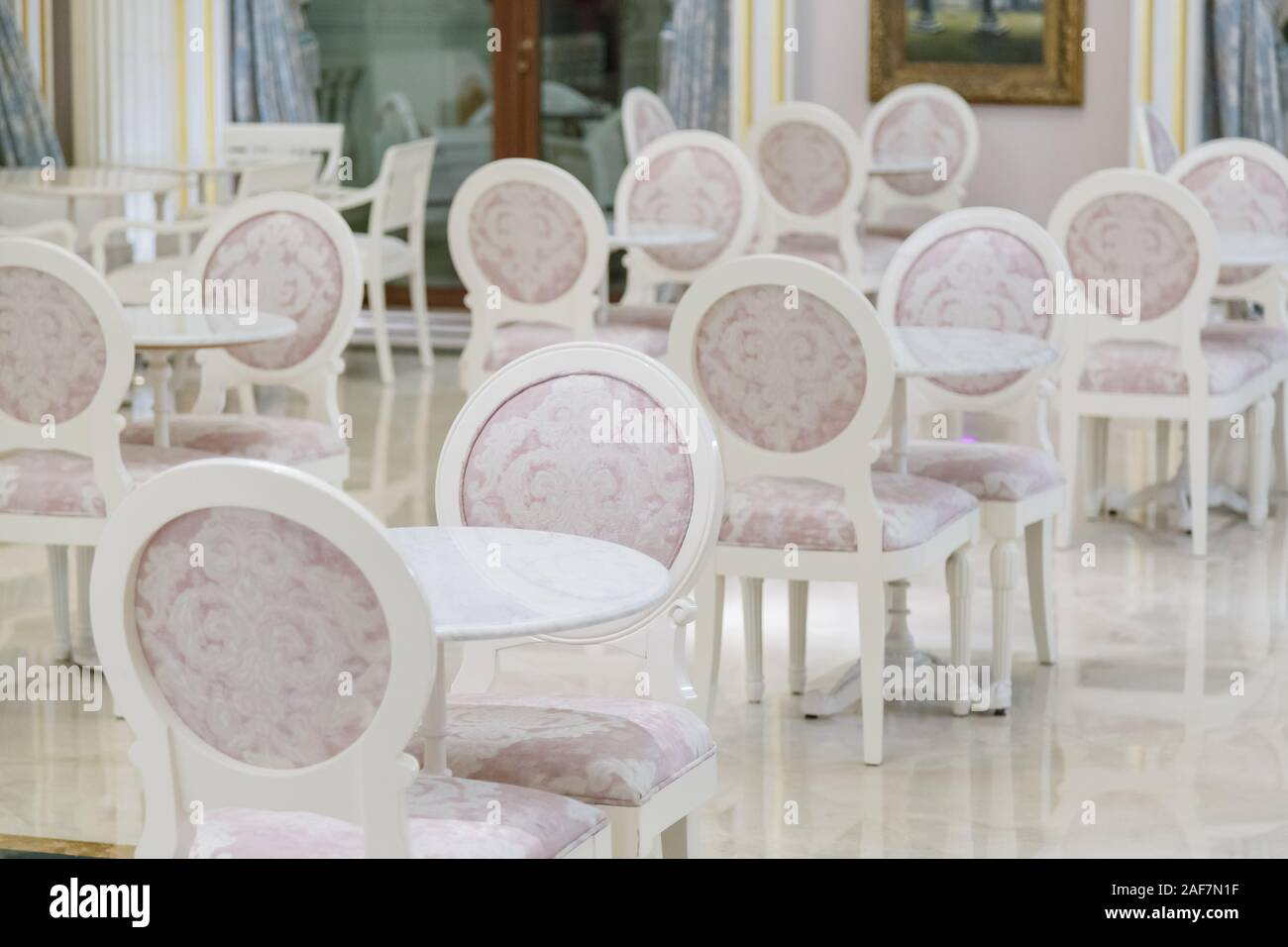 Round White Marble Tables And Chairs In Cafe Stock Photo Alamy