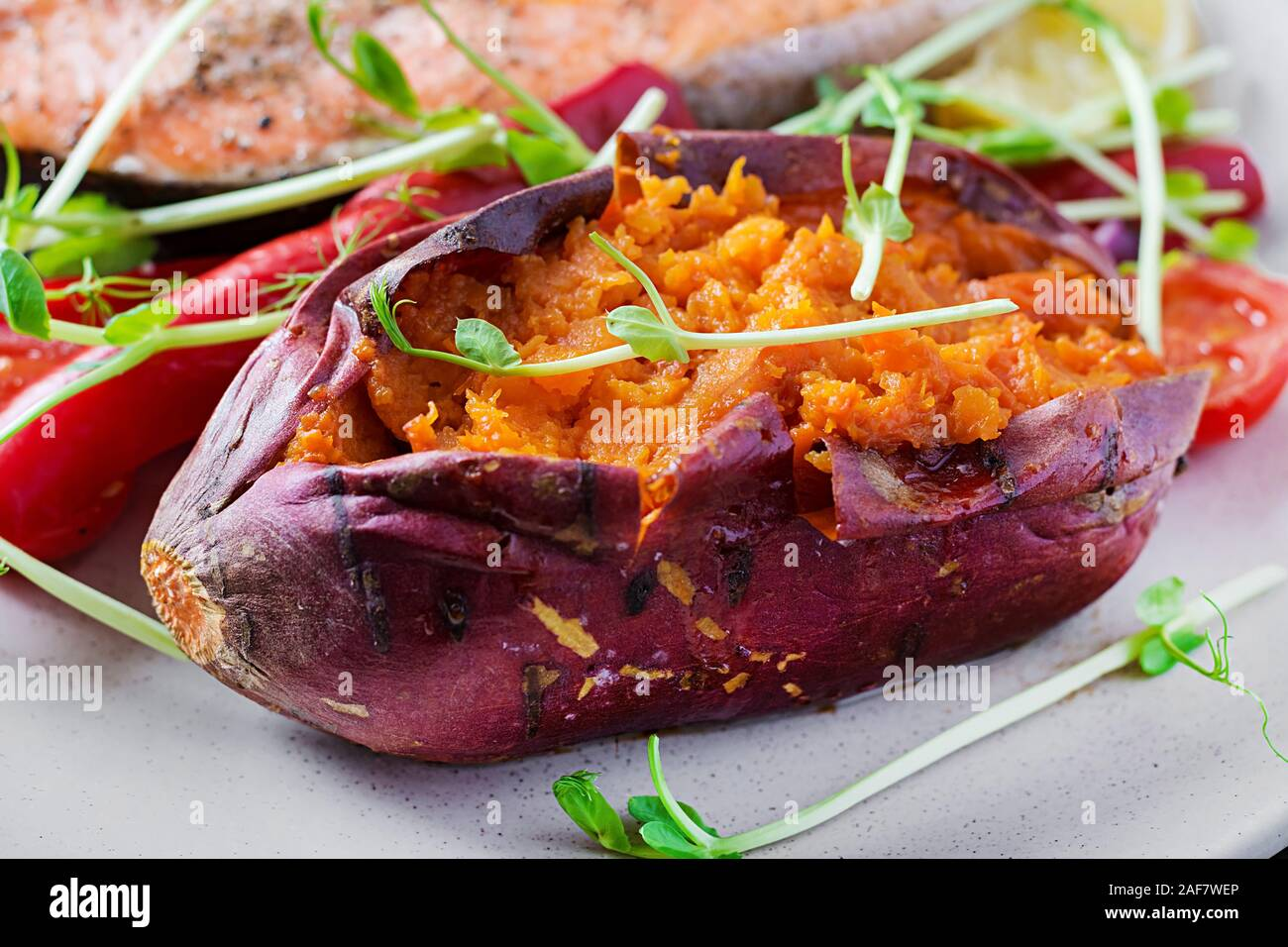 Baked sweet potatoes with butter. Vegetarian cuisine. Diet menu. Stock Photo