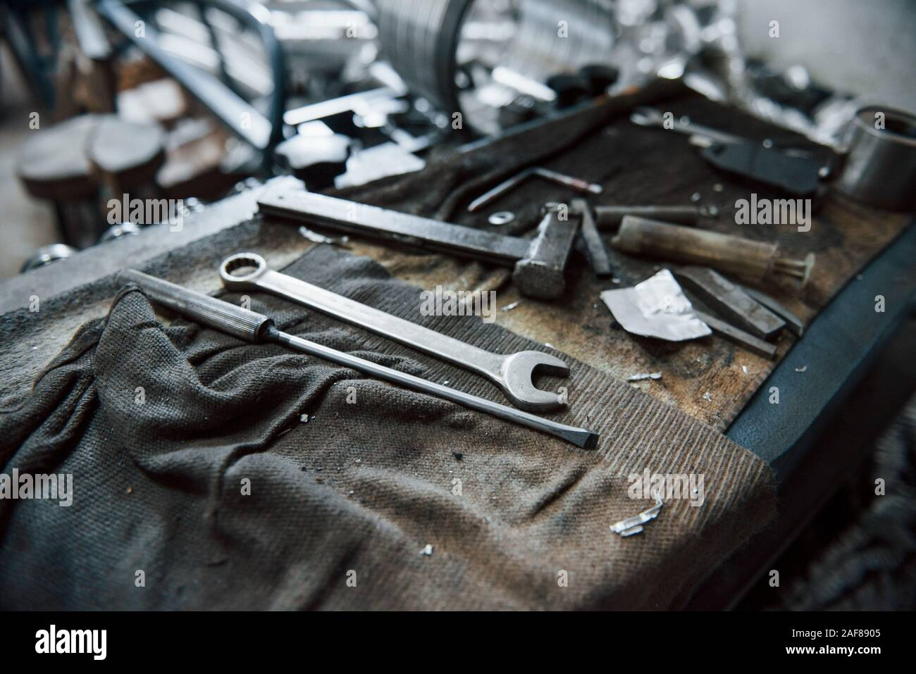 Place of work. Tools on dirty table. In garage. Manufactory conception Stock Photo