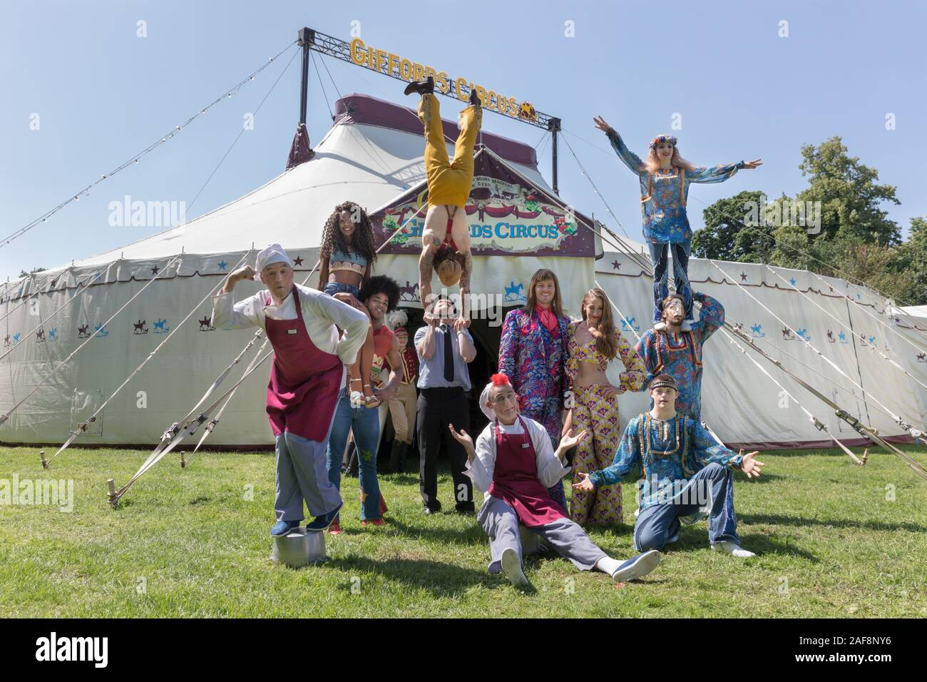 Performers, clowns and acrobats from different acts pose in front the circus tent.  Gifford's Circus present their new show 'Xanadu' at Chiswick House Stock Photo