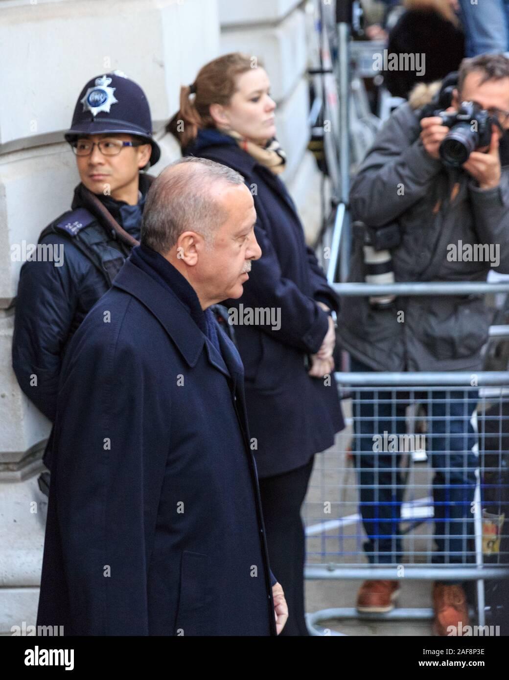 Recep Tayyip Erdoğan, President of Turkey, Turkish PM and politician walks past press on a visit in n Downing Street, London, UK, December 2019 Stock Photo