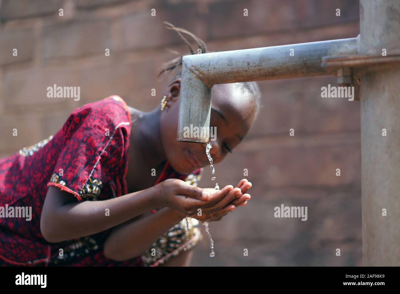 Gorgeous African Ethnicity Girl Happy to Finally Get Fresh Clean Water Stock Photo