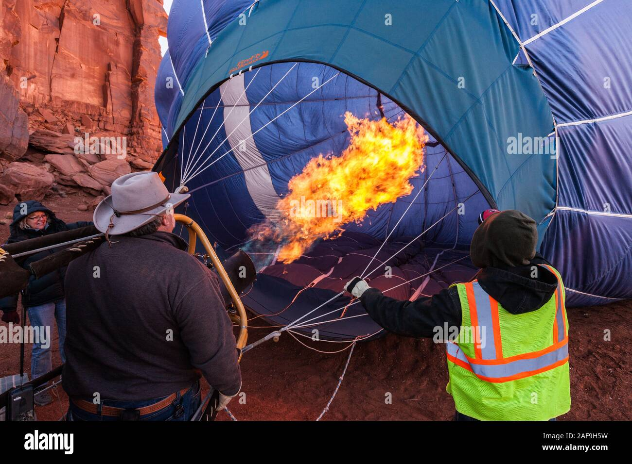 A hot air balloon fills with hot air from a buner in preparation for launch in the Monument Valley Balloon Festival in the Monument Valley Navajo Trib Stock Photo