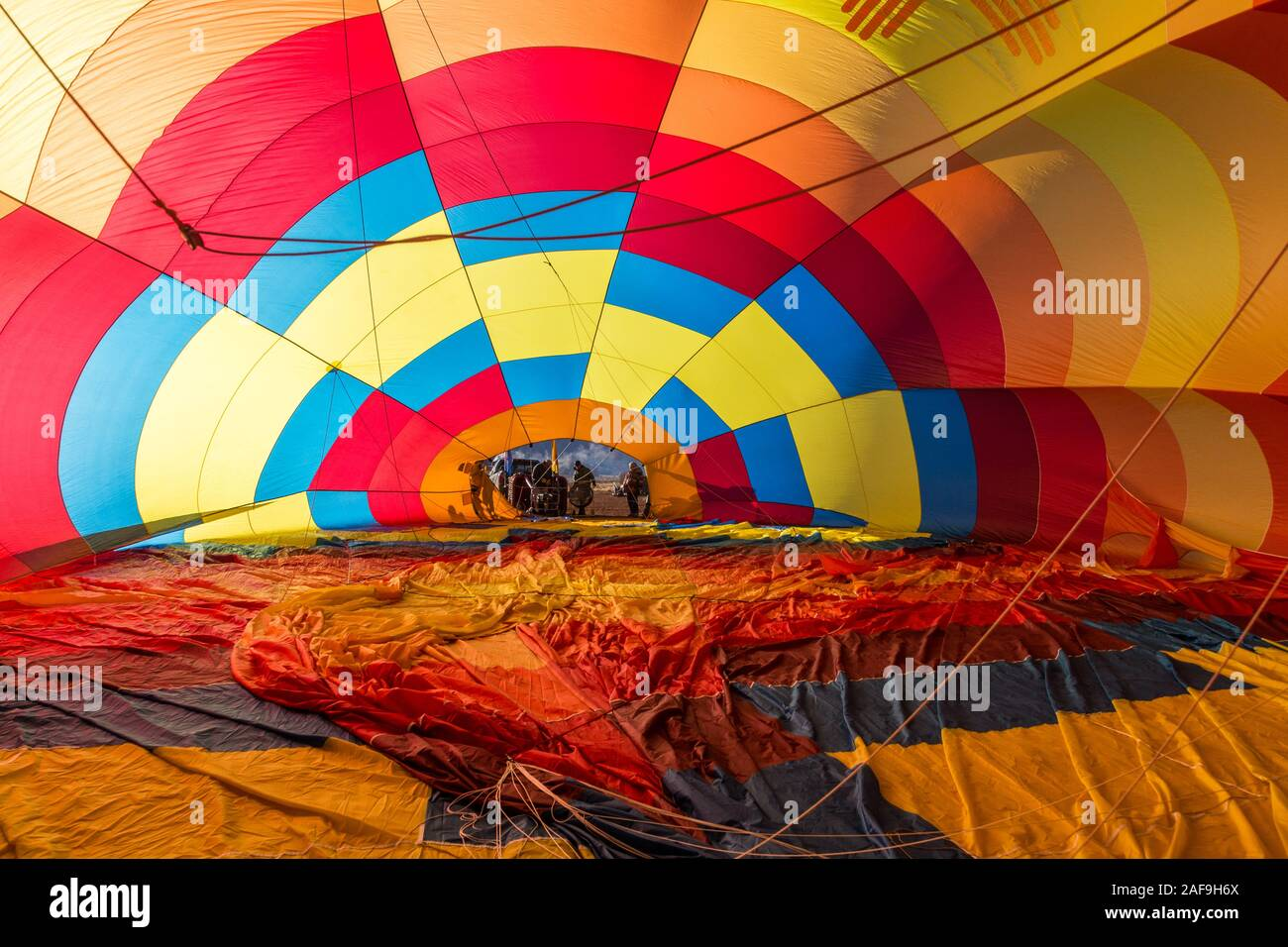 Inside a hot air balloon filling with hot air in preparation for launching in the Monument Valley Balloon Festival in the Monument Valley Navajo Triba Stock Photo