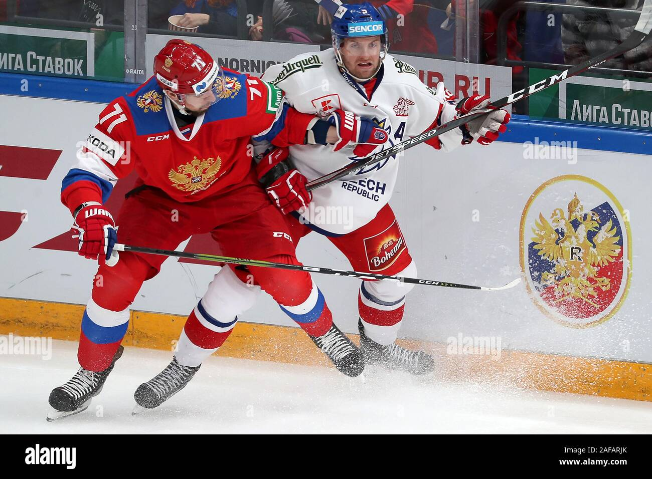 Moscow, Russia. 14th Dec, 2019. MOSCOW, RUSSIA - DECEMBER 14, 2019: Russia's Anton Burdasov (L) and the Czech Republic's Jakub Jerabek in their 2019/20 Euro Hockey Tour Channel One Cup ice hockey match at CSKA Arena. Mikhail Tereshchenko/TASS Credit: ITAR-TASS News Agency/Alamy Live News Stock Photo