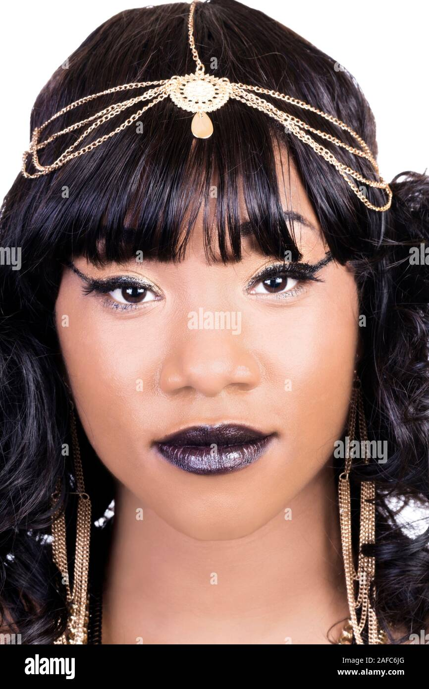 Close Portrait Of African American Woman On White Background Wearing Gold Chain Jewelry Stock Photo