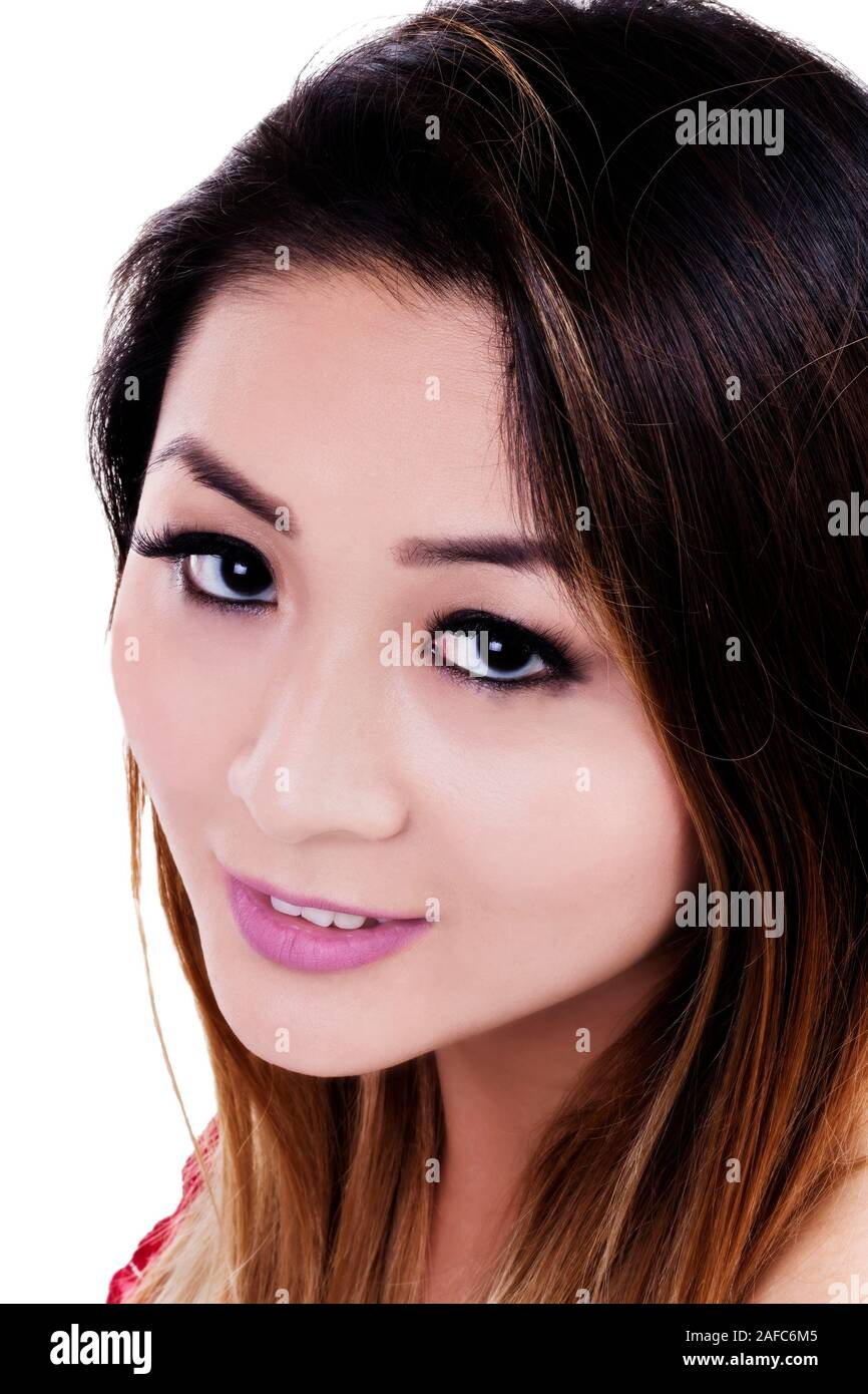 Attractive Asian American Woman Close Portrait On White Background Looking Up At Camera Stock Photo