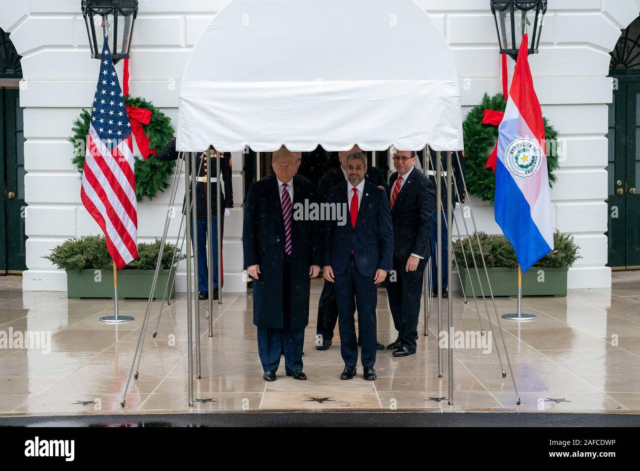 Washington, United States Of America. 13th Dec, 2019. President Donald J. Trump poses for a photo with Paraguay President Mario Abdo Benitez Friday, Dec. 13, 2019, at the South Portico of the White House People: President Donald J. Trump, Paraguay President Mario Abdo Benitez Credit: Storms Media Group/Alamy Live News Stock Photo