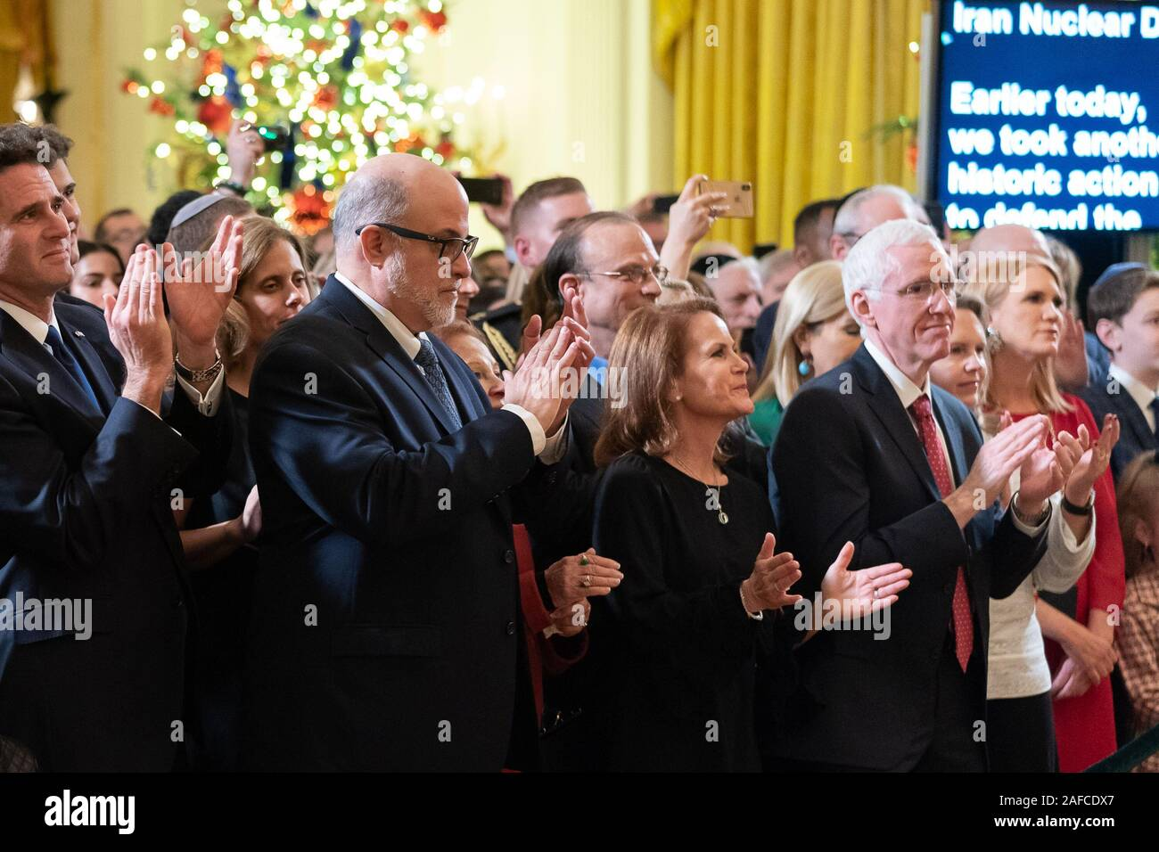 Washington, United States Of America. 11th Dec, 2019. Israeli Ambassador to the United States Ron Dermer and conservative commentator Mark Levin join guests as they applaud President Donald J. Trump during a Hanukkah Reception Wednesday, Dec. 11, 2019, in the East Room of the White House People: Israeli Ambassador to the United States Ron Dermer and conservative commentator Mark Levin Credit: Storms Media Group/Alamy Live News Stock Photo