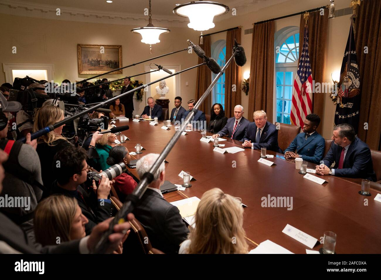 Washington, United States Of America. 09th Dec, 2019. President Donald J. Trump, joined by Vice President Mike Pence, delivers remarks at a roundtable on empowering families with education choice Monday, Dec. 9, 2019, in the Cabinet Room of the White House. People: President Donald Trump Credit: Storms Media Group/Alamy Live News Stock Photo