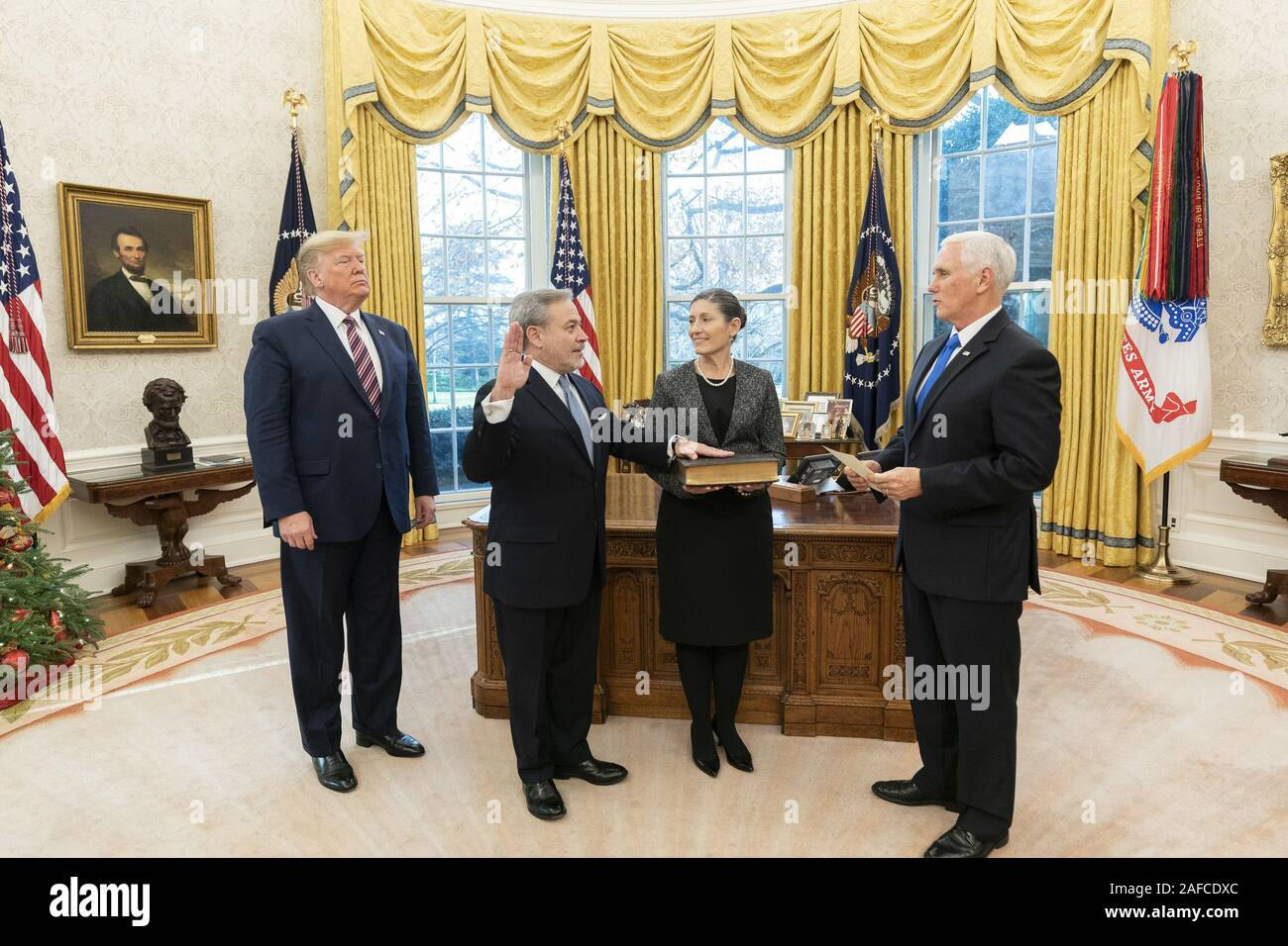 Washington, United States Of America. 11th Dec, 2019. President Donald J. Trump and Adrienne Brouillette look on as Vice President Mike Pence swears in Secretary of Energy Dan Brouillette Wednesday, Dec. 11, 2019, in the Oval Office of the White House. People: President Donald J. Trump, Dan Brouillette Credit: Storms Media Group/Alamy Live News Stock Photo
