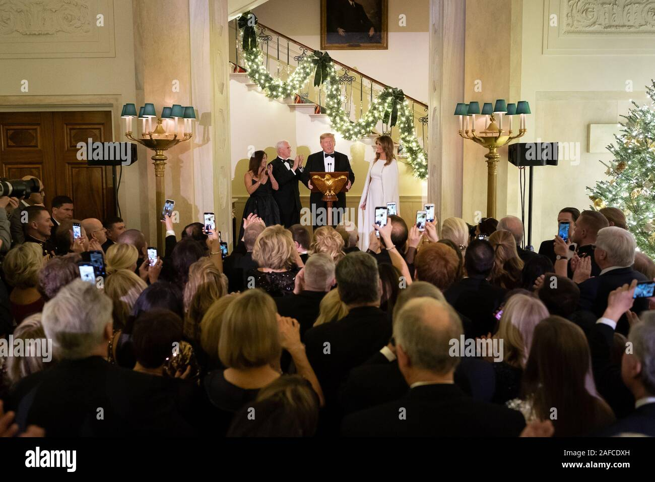 Washington, United States Of America. 12th Dec, 2019. President Donald J. Trump, joined by First Lady Melania Trump, Vice President Mike Pence and Second Lady Karen Pence, delivers remarks during the Congressional Ball Thursday, Dec. 12, 2019, in the Grand Foyer of the White House People: President Donald J. Trump, joined by First Lady Melania Trump Credit: Storms Media Group/Alamy Live News Stock Photo