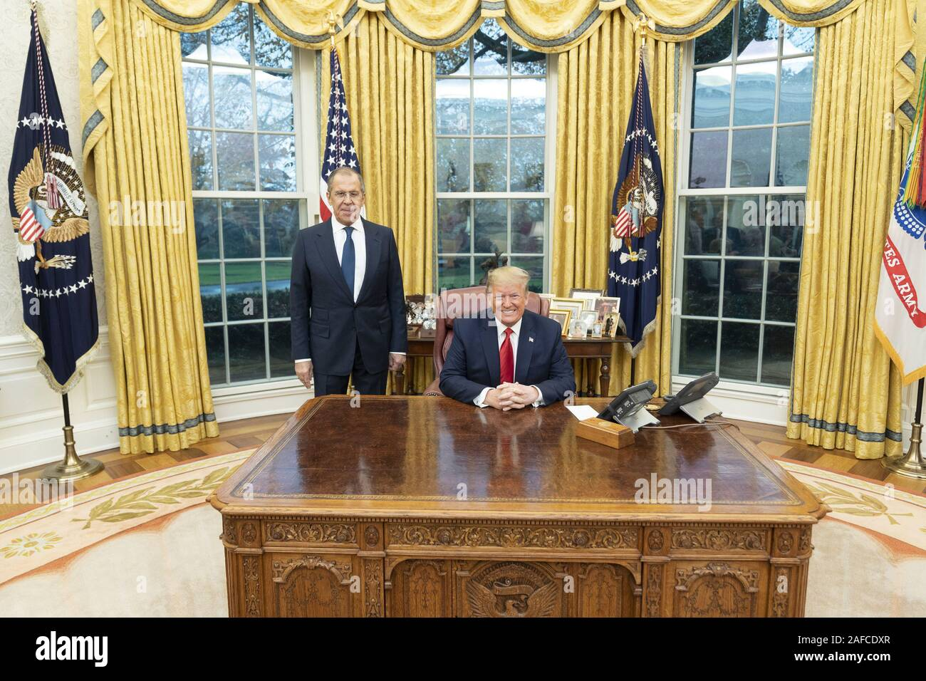Washington, United States Of America. 10th Dec, 2019. President Donald J. Trump poses for a photo with Russian Foreign Minister Sergey Lavrov Tuesday, Dec. 10, 2019, in the Oval Office of the White House. People: President Donald J. Trump, Russian Foreign Minister Sergey Lavrov Credit: Storms Media Group/Alamy Live News Stock Photo