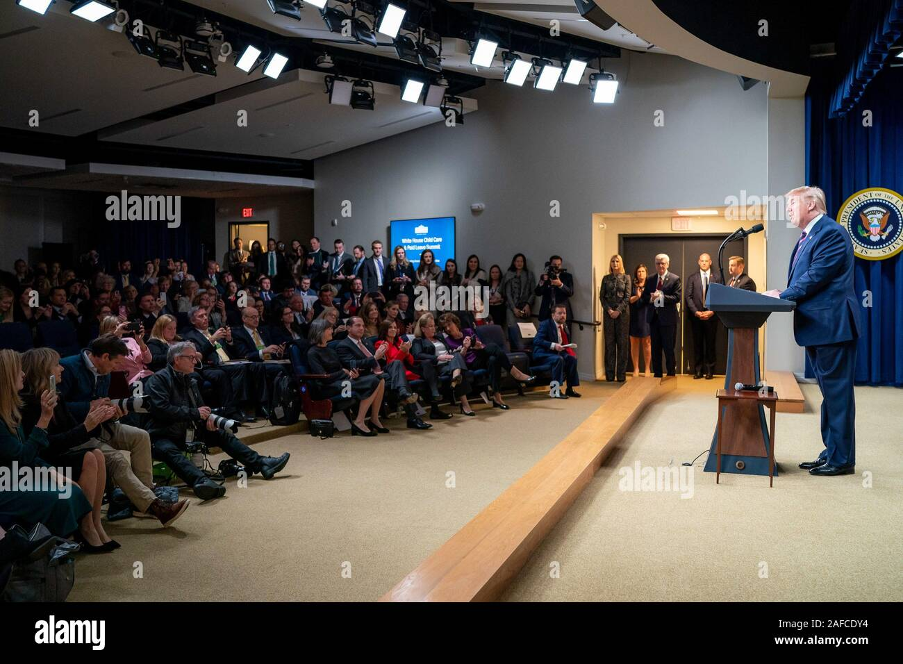 Washington, United States Of America. 12th Dec, 2019. President Donald J. Trump delivers remarks at the White House Summit on Child Care and Paid Leave: Supporting AmericaÕs Working Families Thursday, Dec. 12, 2019, in the South Court Auditorium of the Eisenhower Executive Office Building of the White House. People: President Donald J. Trump Credit: Storms Media Group/Alamy Live News Stock Photo