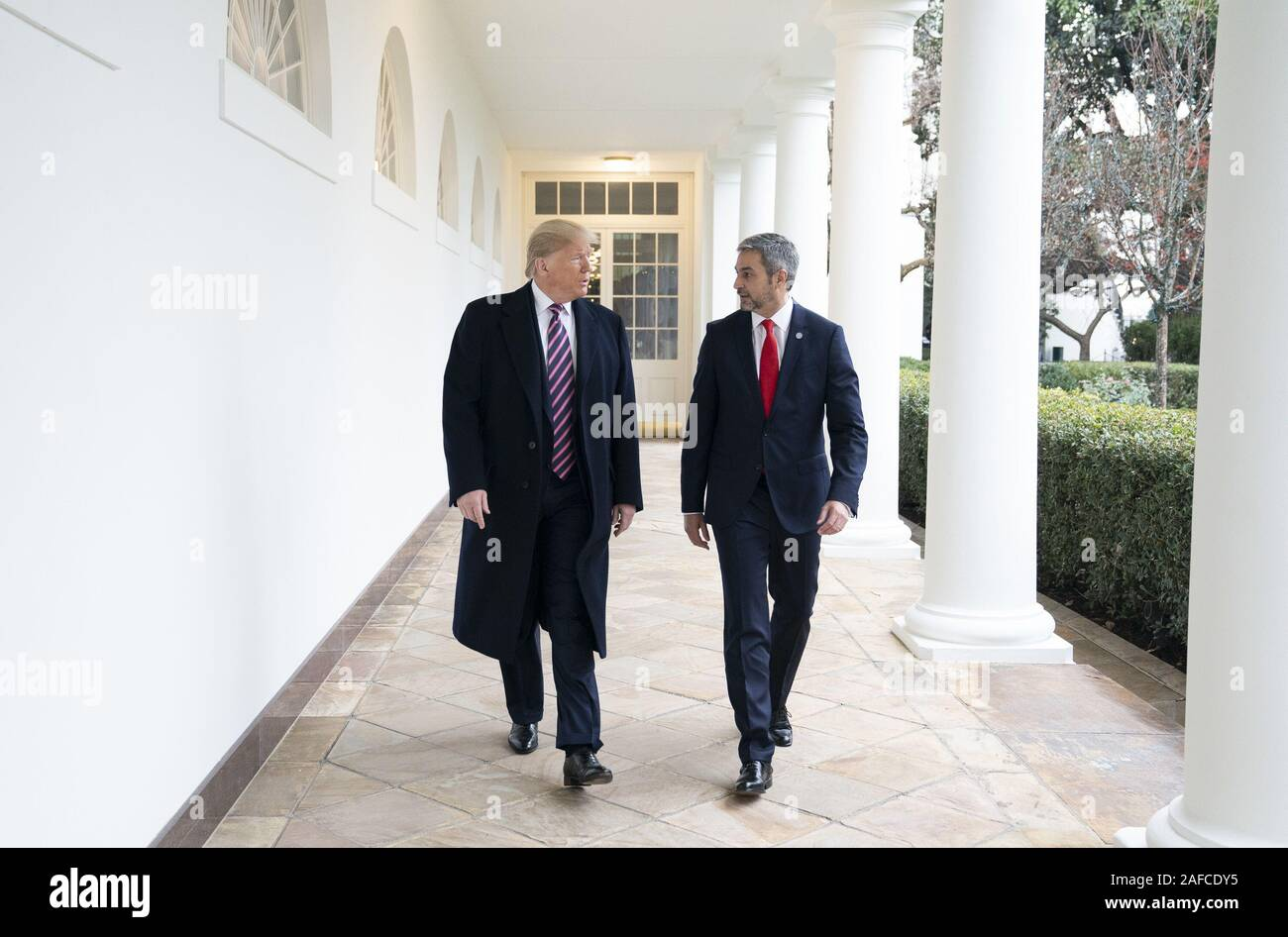 Washington, United States Of America. 13th Dec, 2019. President Donald J. Trump walks with Paraguay President Mario Abdo Benitez Friday, Dec. 13, 2019, along the Colonnade of the White House People: President Donald J. Trump, Paraguay President Mario Abdo Benitez Credit: Storms Media Group/Alamy Live News Stock Photo
