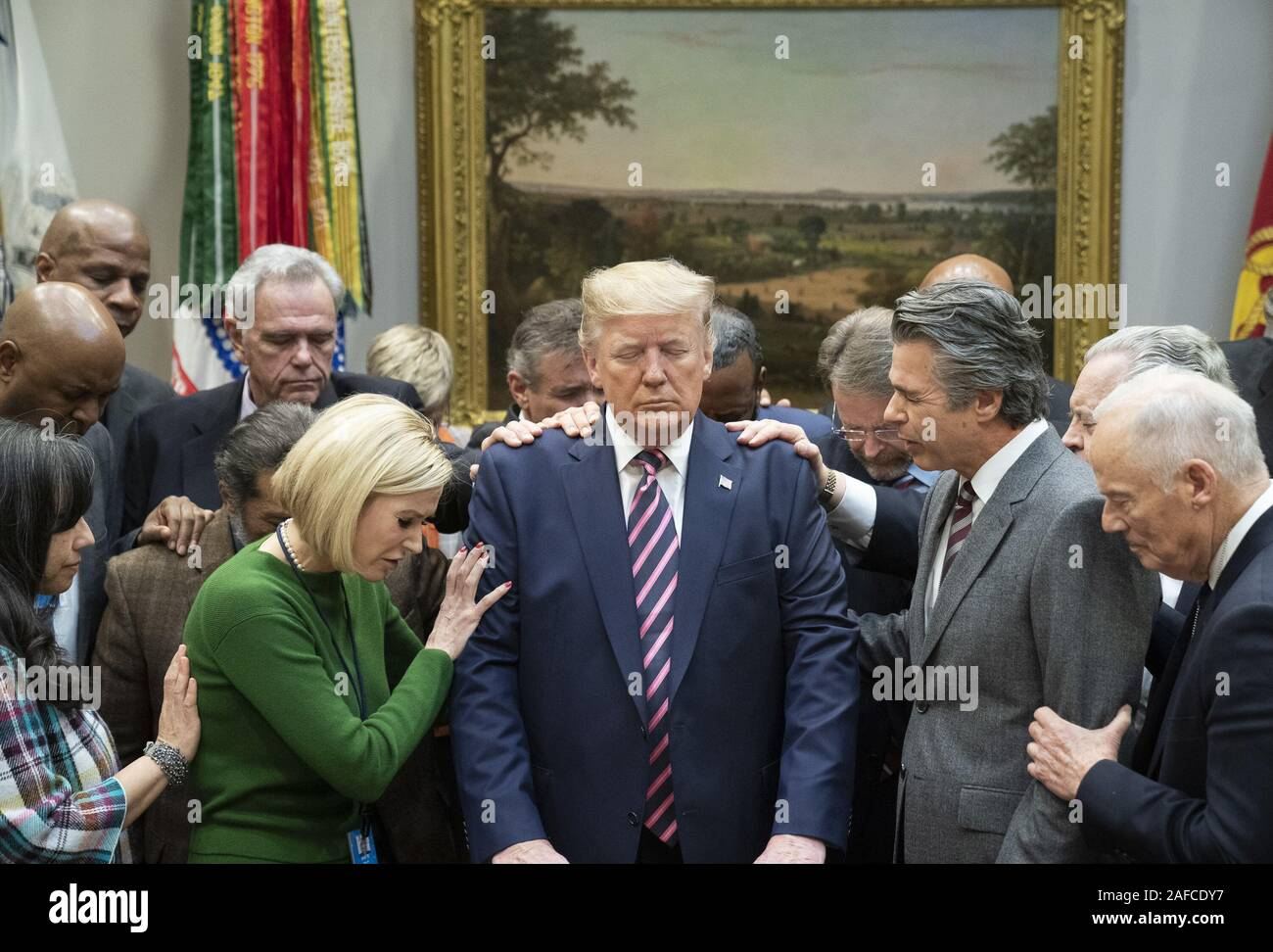 Washington, United States Of America. 12th Dec, 2019. President Donald J. Trump joins faith leaders in prayer Thursday, Dec. 12, 2019, during a meeting in the Roosevelt Room of the White House People: President Donald J. Trump Credit: Storms Media Group/Alamy Live News Stock Photo