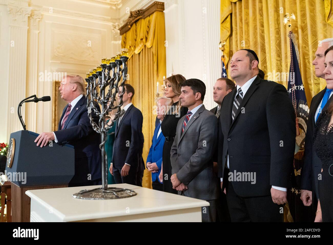 Washington, United States Of America. 11th Dec, 2019. President Donald J. Trump, joined by First Lady Melania Trump, delivers remarks at a Hanukkah Reception Wednesday, Dec. 11, 2019, in the East Room of the White House. People: President Donald J. Trump, First Lady Melania Trump Credit: Storms Media Group/Alamy Live News Stock Photo