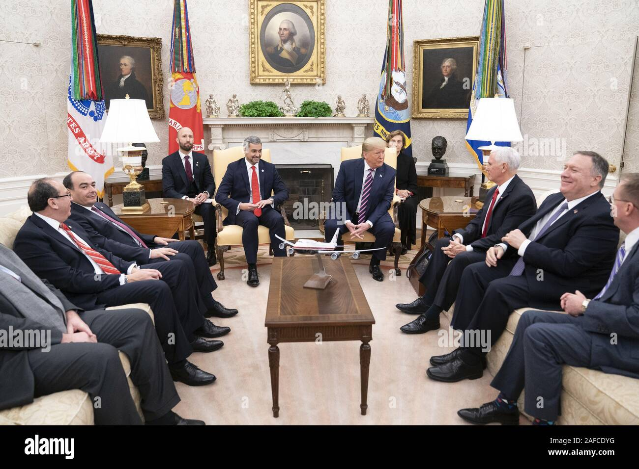 Washington, United States Of America. 13th Dec, 2019. President Donald J. Trump and Vice President Mike Pence, joined by White House senior advisors, participates in an expanded bilateral meeting with Paraguay President Mario Abdo Benitez Friday, Dec. 13, 2019, in the Oval Office of the White House People: President Donald J. Trump, Mario Abdo Benitez Credit: Storms Media Group/Alamy Live News Stock Photo