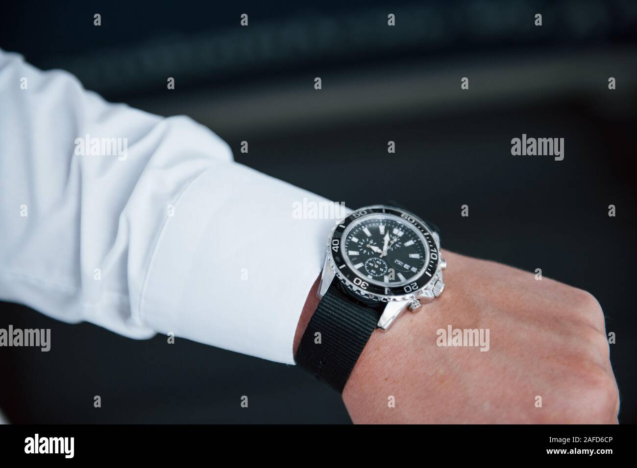 Close up photo of man's hand in suit with luxury watch Stock Photo