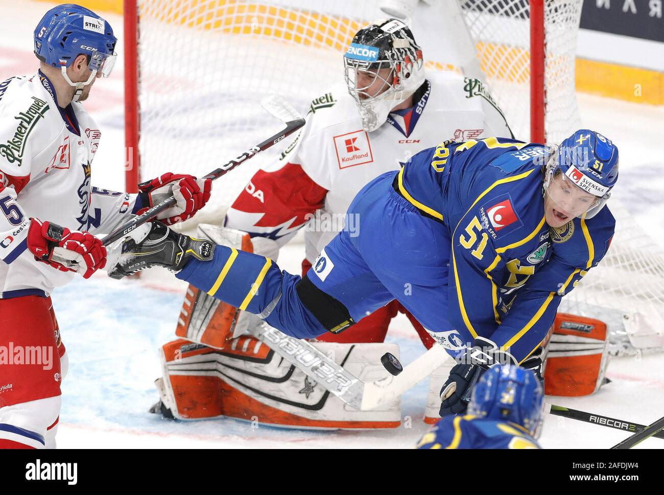 Moscow, Russia. 15th Dec, 2019. MOSCOW, RUSSIA - DECEMBER 15, 2019: The Czech Republic's Jakub Jerabek, goalie Marek Langhamer and Sweden's Emil Sylvegard (L-R) in their 2019/20 Euro Hockey Tour Channel One Cup ice hockey match at CSKA Arena. Mikhail Japaridze/TASS Credit: ITAR-TASS News Agency/Alamy Live News Stock Photo