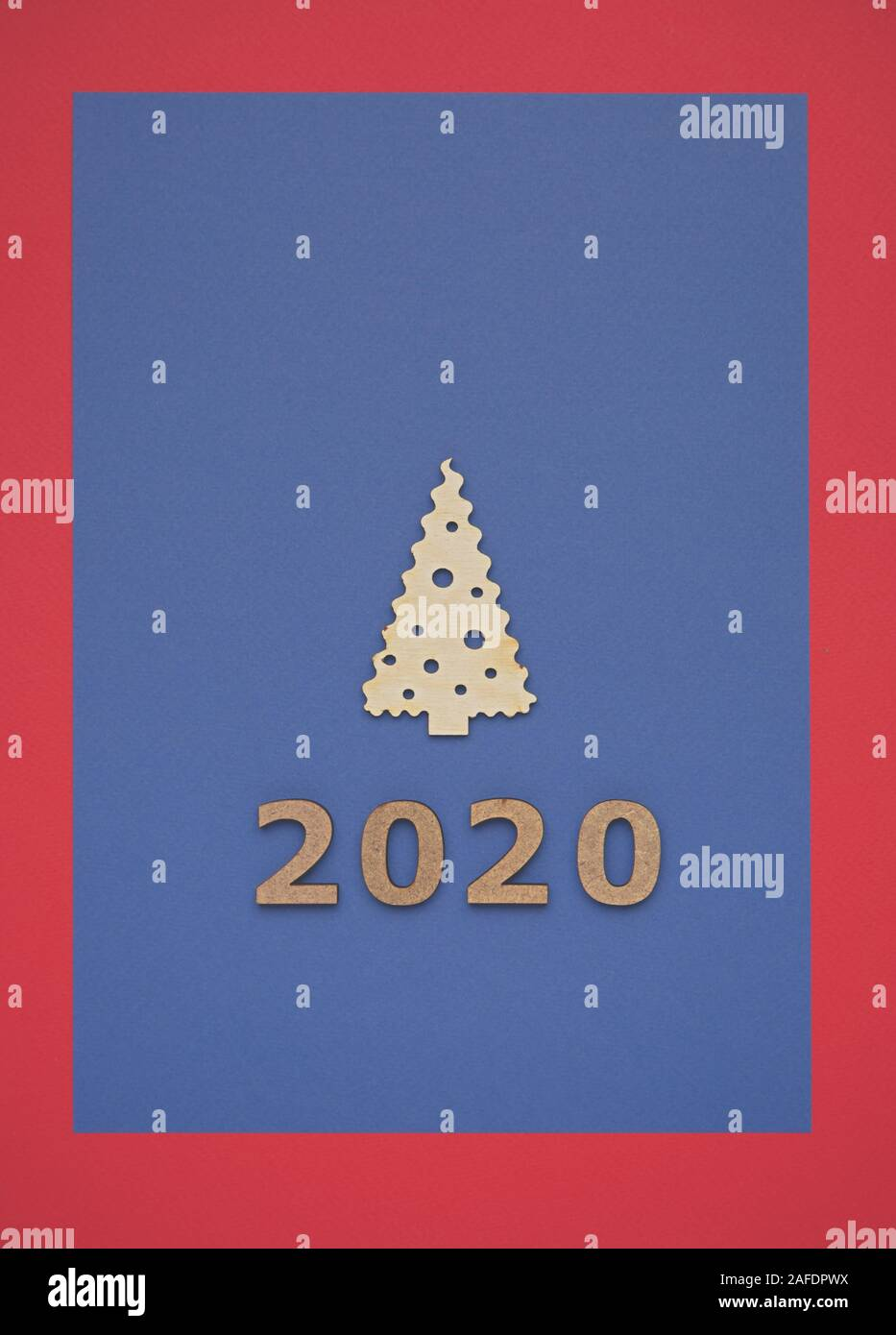 Flat Lay New Year 2020 Poster With Wooden Christmas Tree On Blue Paper Background Shot Directly From Above Winter Holidays Poster Template With Rustic Stock Photo Alamy