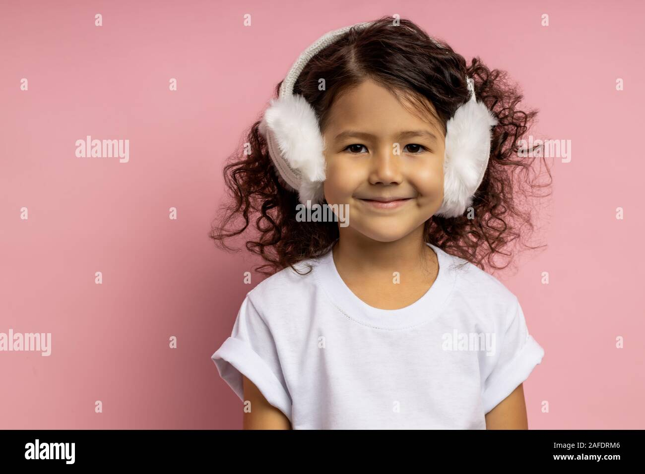 Close Up Studio Portrait Of Little Girl 5 Y O With Dark Curly
