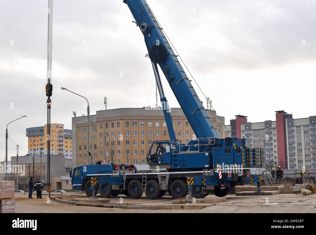 07.12.2019 Minsk, Belarus: The telescopic mobile crane Grove GMK 6300 L  at construction site. Auto crane during the unloading of cargo and building m Stock Photo