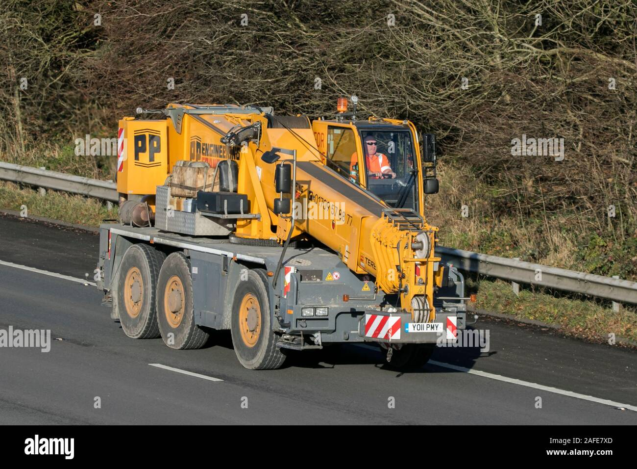 PP engineering telehandler driving on the M61 motorway near Manchester, UK Stock Photo