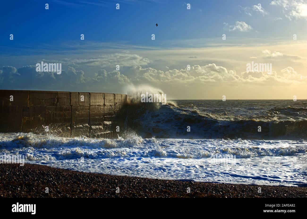 waves crashing on the marina arm Stock Photo