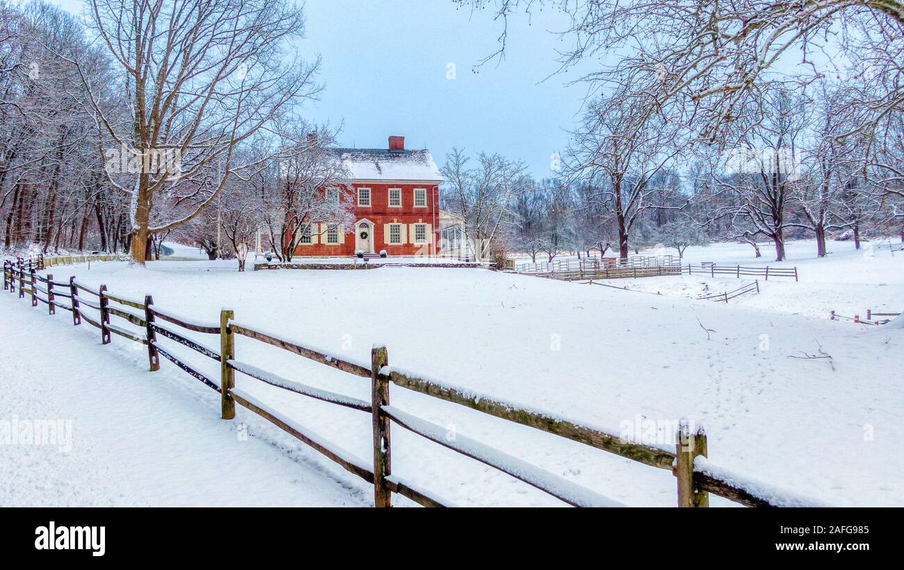 Lancaster, Pennsylvania - Jan 13 2019: Rock Ford plantation in Lancaster, PA in winter, colonial residential home in snow covered countryside Stock Photo