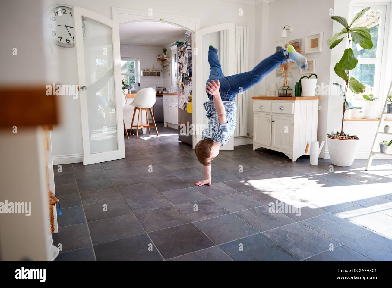 Young Downs Syndrome Man Having Fun Breakdancing At Home Stock Photo