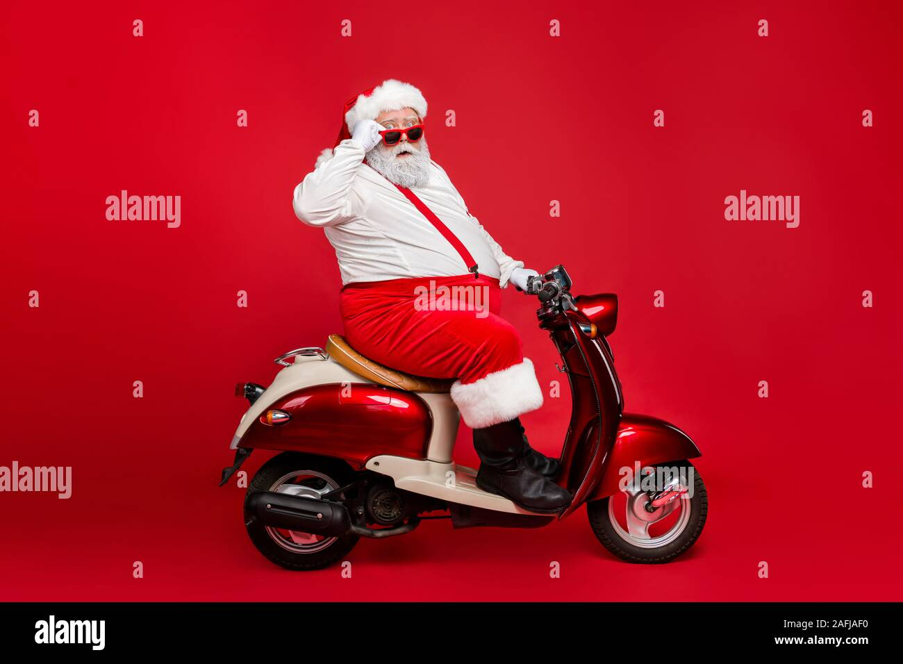 Profile Side View Portrait Of Nice Bearded Confused Amazed Funny Funky Santa Riding Moped Hurry Up Cool Winter Season Discount Shopping Mall Isolated Stock Photo Alamy