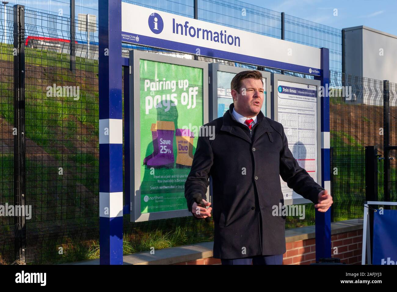 Warrington, Cheshire, UK. 16th Dec, 2019. Thomas Edgcumbe, Managing Director (UKCS North and Midlands) at Balfour Beatty plc, addresses the guests at the official opening of Warrington West Railway Station on 16 December 2019 Credit: John Hopkins/Alamy Live News Stock Photo