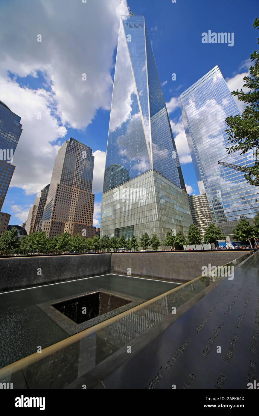 9/11 - 0911 - National September 11 Memorial North Tower Fountain,with One World Trade Center,Lower Manhattan,New York City, NY, USA Stock Photo