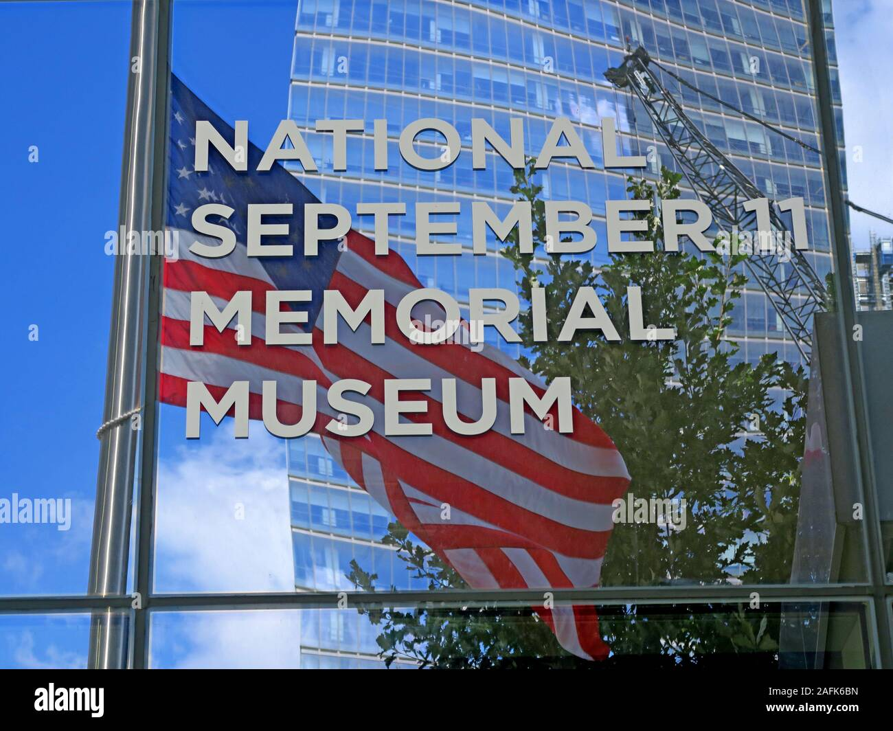 09/11 - 0911 - National September 11 Memorial Museum,One World Trade Center,Lower Manhattan,New York City, NY, USA with stars and stripes flag Stock Photo