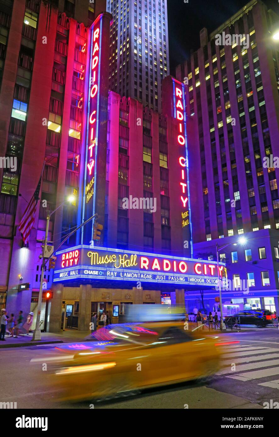 Radio City Music Hall facade New York, 1260 Avenue of the Americas (Sixth Avenue), Manhattan, New York City, NY, USA at night, neon lights Stock Photo