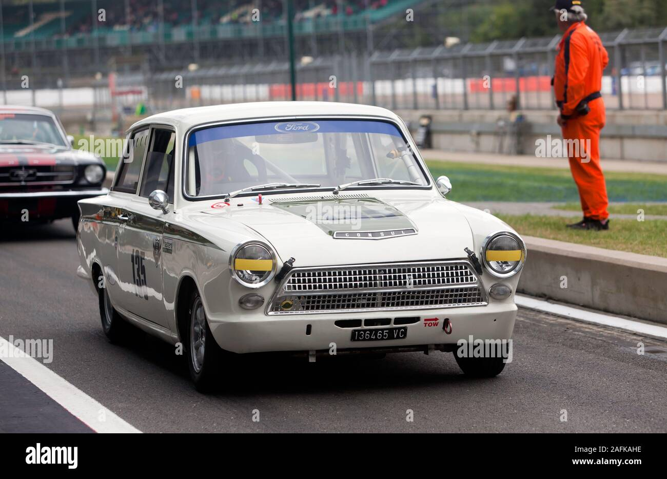 A 1965, White, Ford Lotus Cortina, exiting the pit lane during the Transatlantic Trophy for Pre '66 Touring Cars, at the 2019 Silverstone Classic Stock Photo