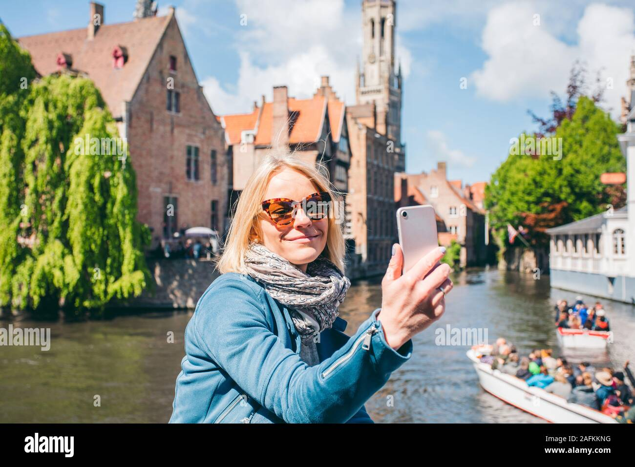 Beautiful Young Girl Takes Selfie Photo On The Background Of The Famous Tourist Destination With A Canal In Bruges Belgium Stock Photo Alamy