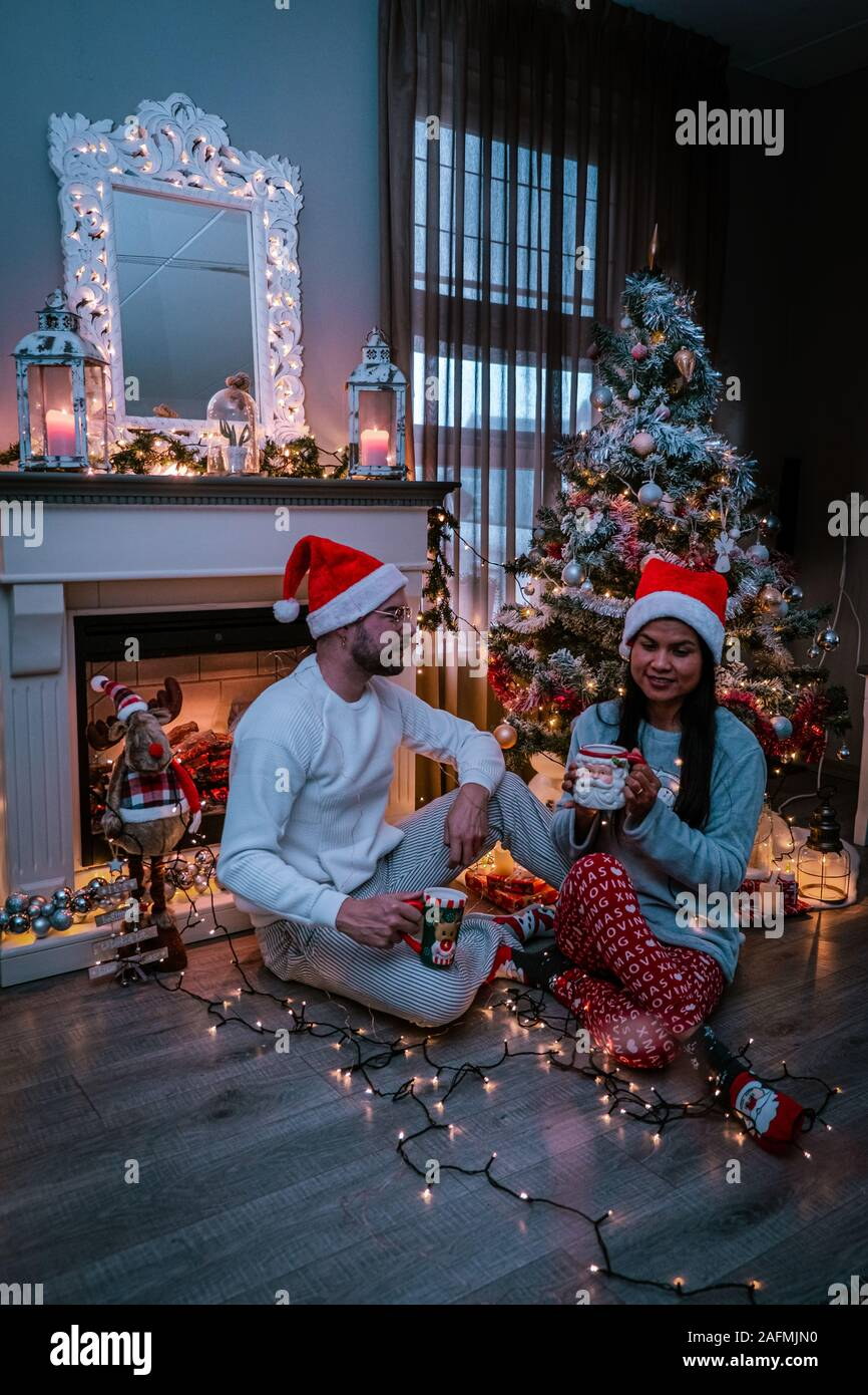 Cute Couple Christmas Tree Couple Drinking Hot Chocolate Under