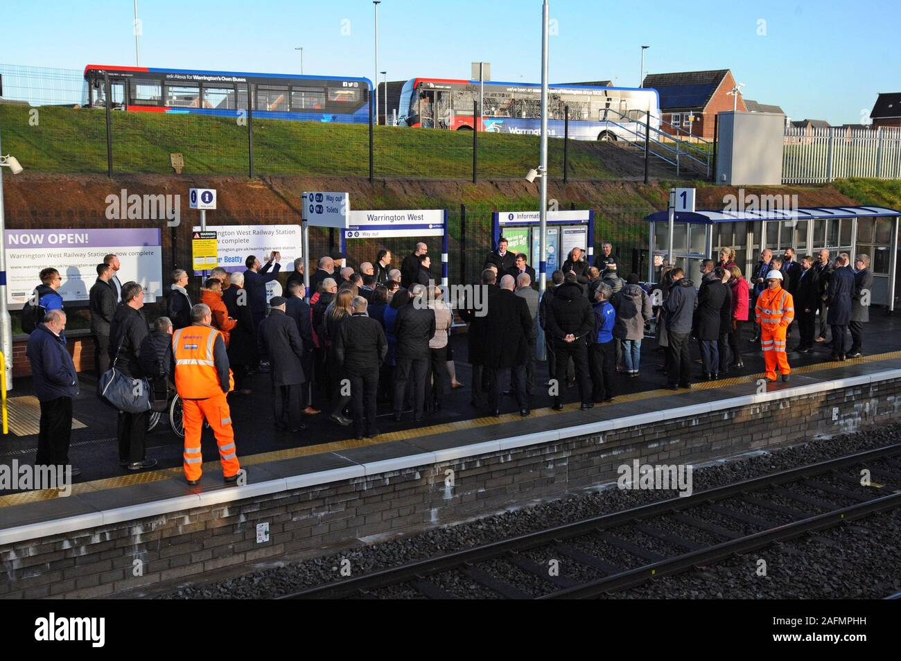 Warrington, Cheshire, UK. 16th Dec, 2019. Council leaders, railway staff and local dignitaries attend the official opening of Warrington West railway station. The £20.5 million station project has been funded by Warrington Borough Council, the Department for Transport, developer contributions and Cheshire and Warrington Local Enterprise Partnership. The station is managed by Northern Trains and will provide vital links for the Chapelford community to Liverpool and Manchester, with 4 trains per hour, a 250 car capacity park and ride and local bus services. Credit: G.P.Essex/Alamy Live News Stock Photo