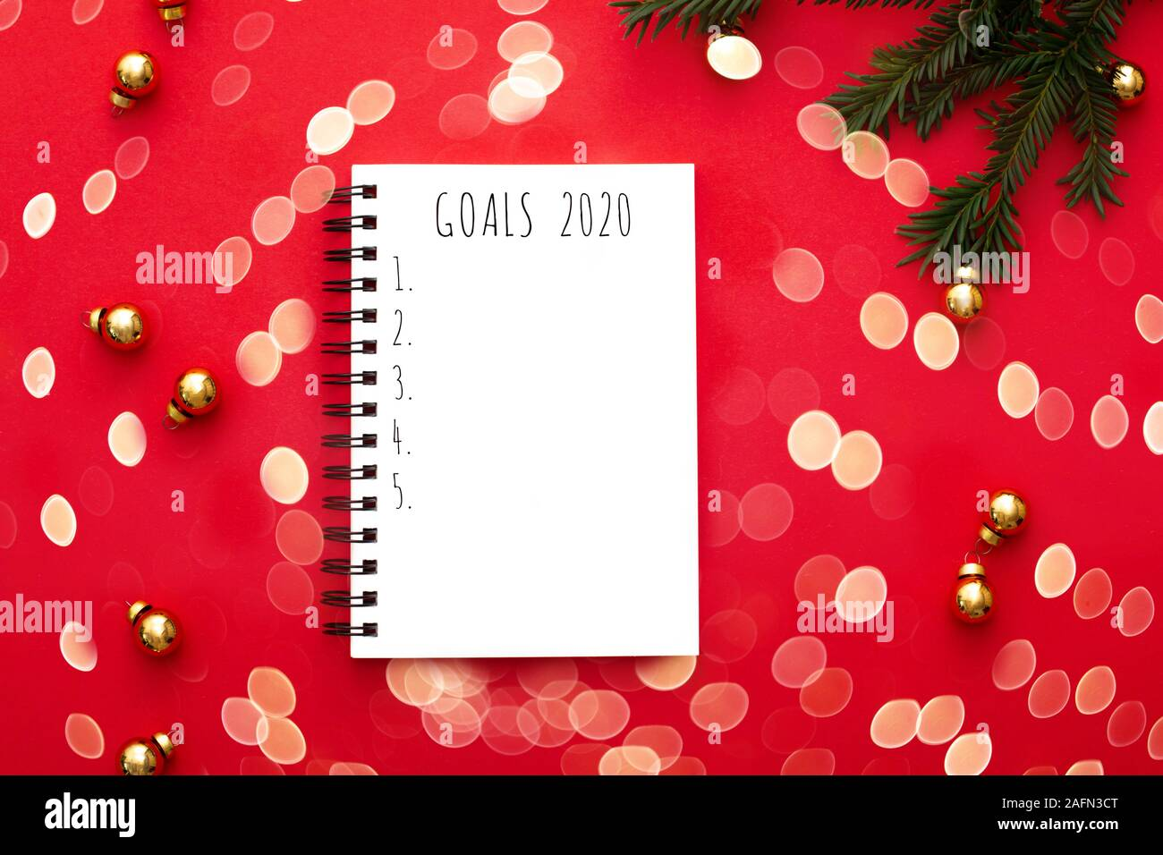 Christmas Brunch 2020 Notebook with 2020 goals on red background with golden christmas