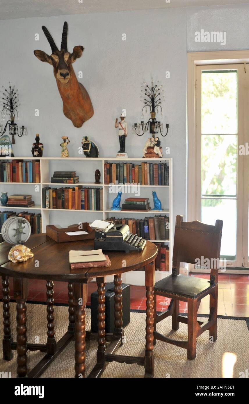 The Study Room in author Ernest Hemingway house, a famous travel destination on tropical Key West, Florida, USA. U.S. National Historic Landmark. Stock Photo