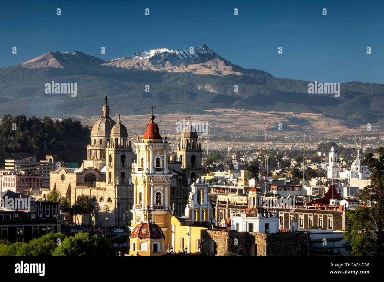 The Nevado de Toluca mountain rises up above the historic downtown of Toluca, Mexico. Stock Photo