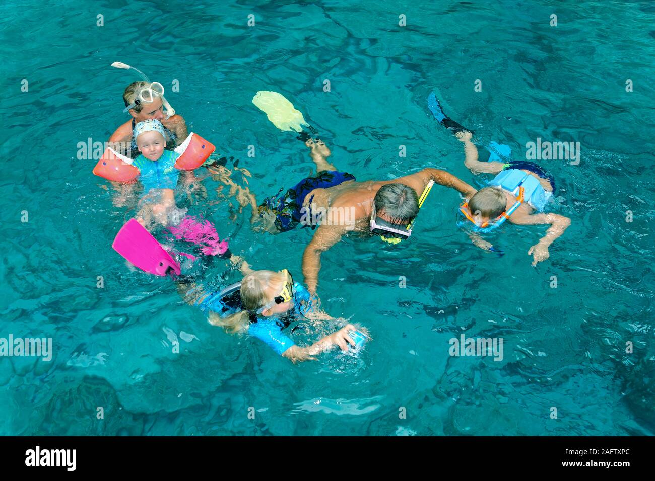 Adult snorkelling with children in Mediterranean sea, Zakynthos island, Greece Stock Photo
