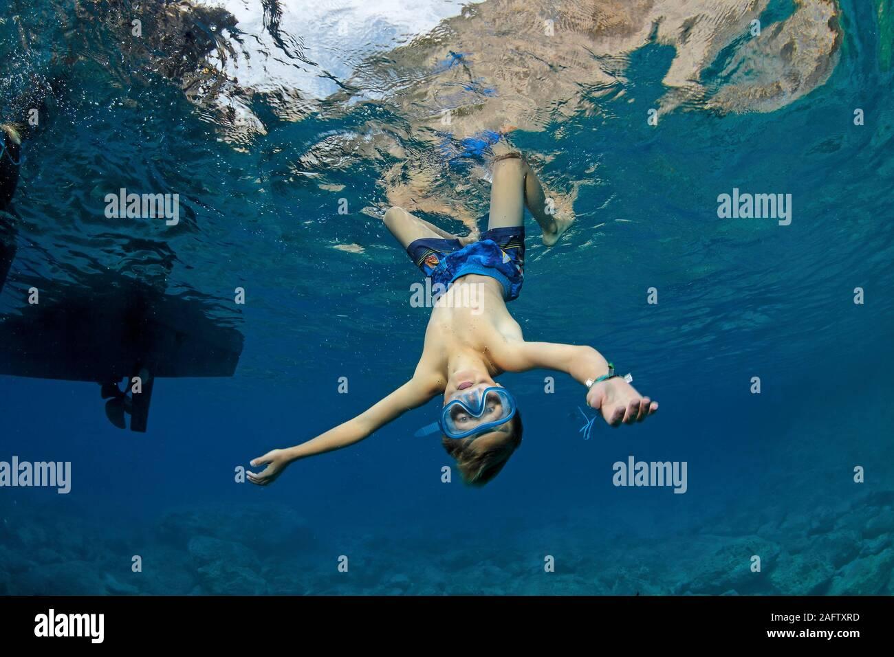 Child playful in warm Mediterranean sea, diving, Zakynthos island, Greece Stock Photo