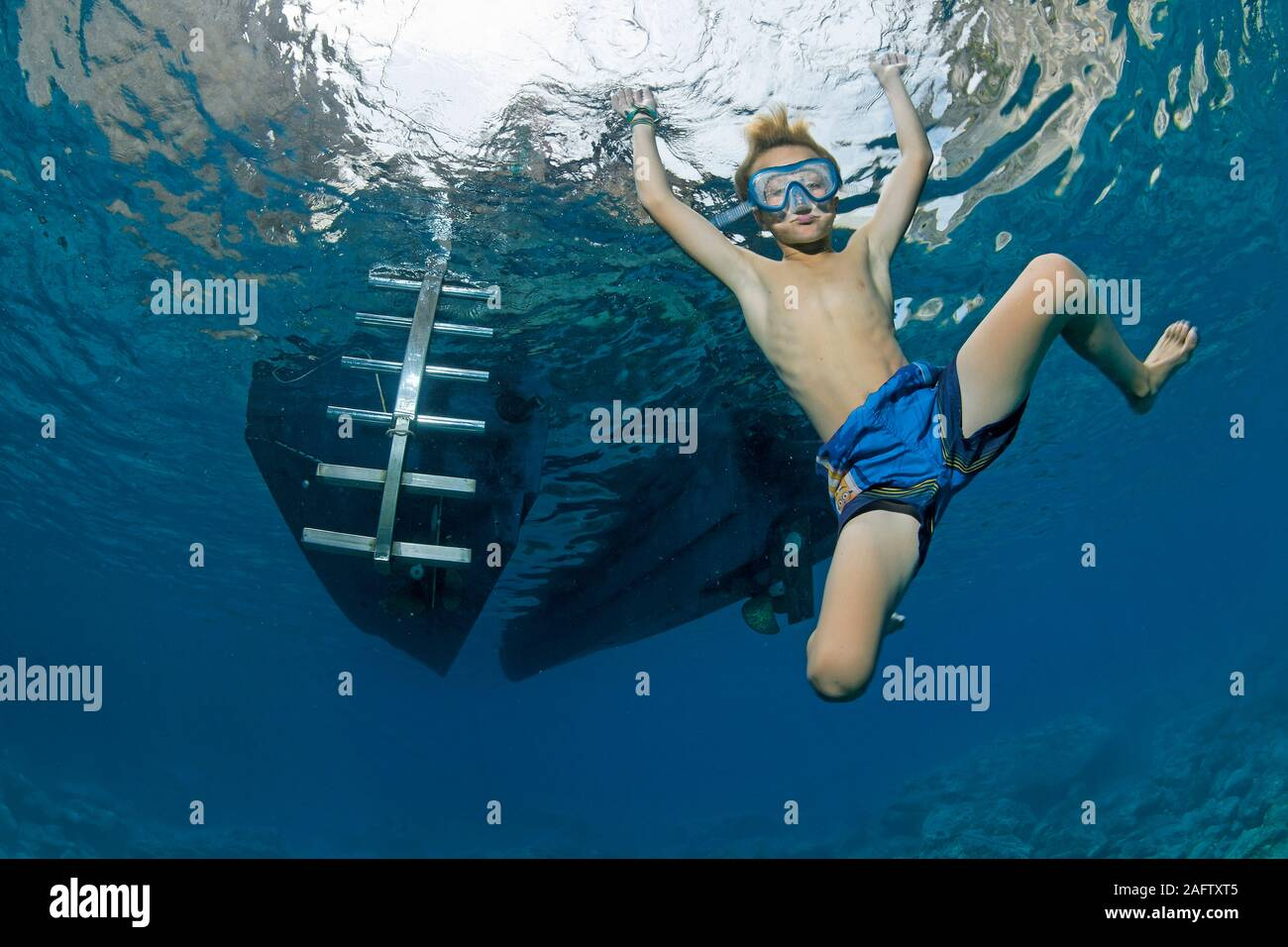 Child playful in warm Mediterranean sea, diving, Zakynthos island, Greece Stock Photo