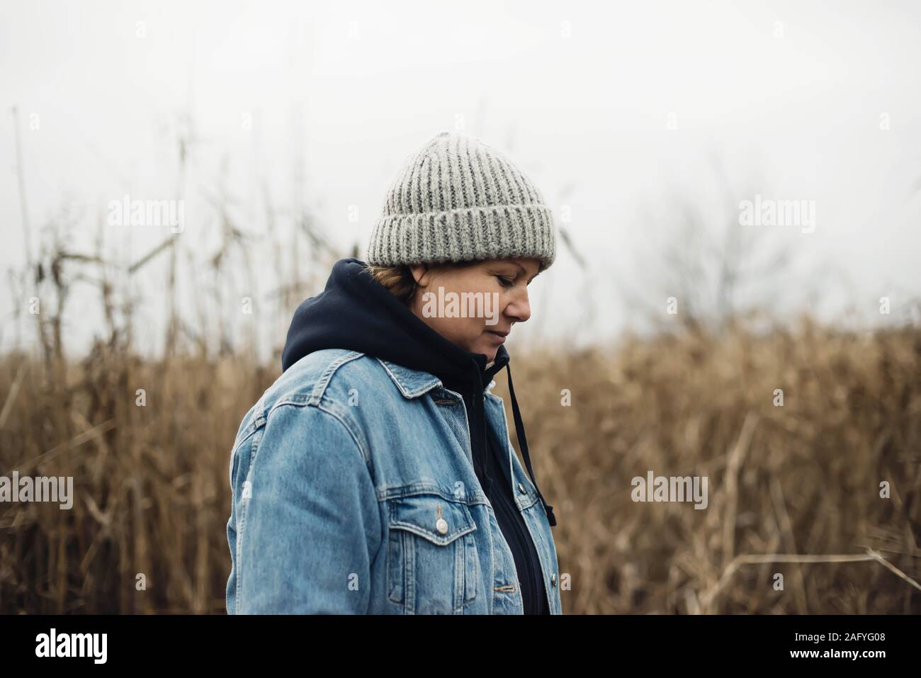 Portrait of a 40 years old woman in a hat outdoors Stock Photo