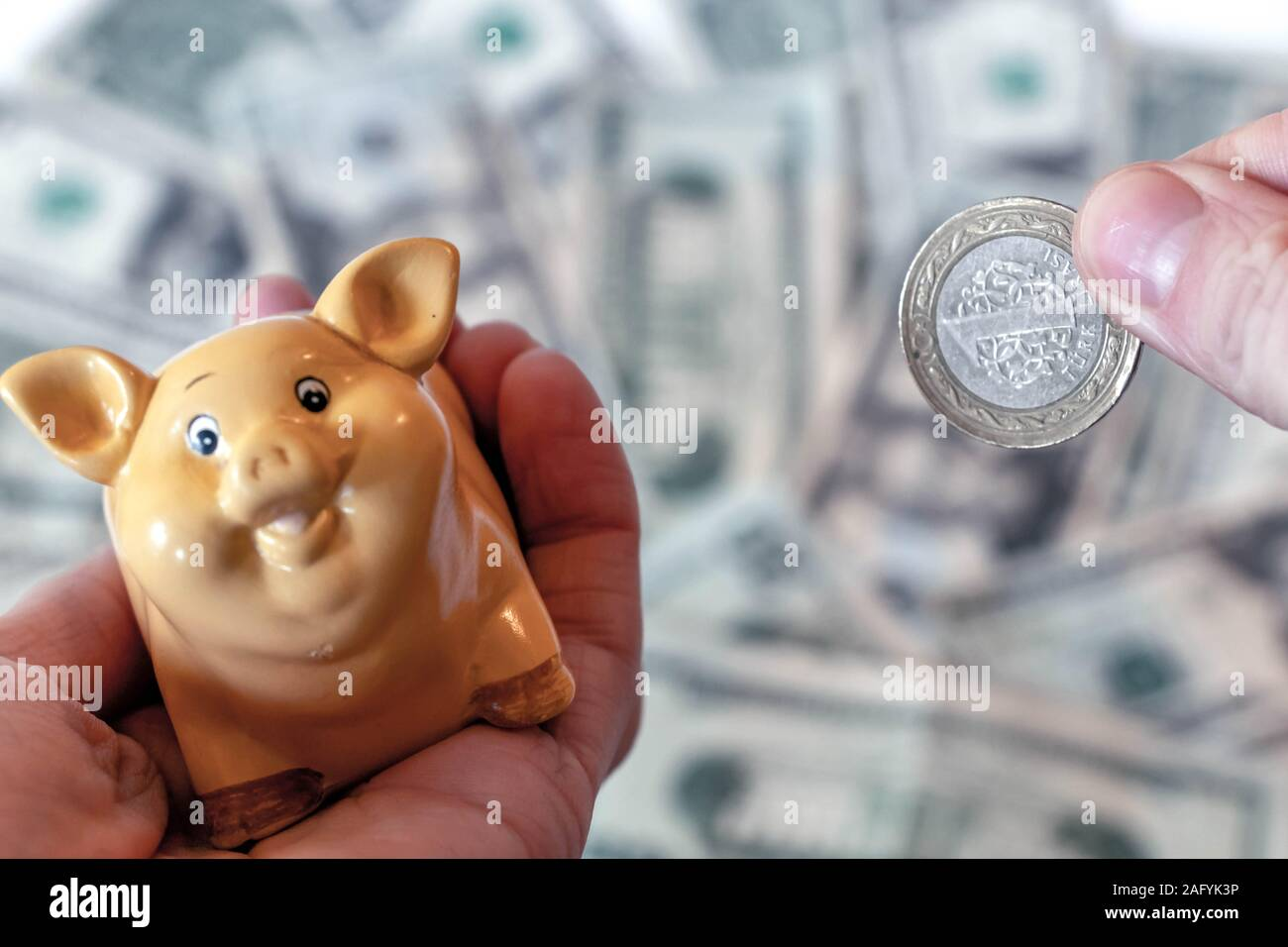 Turkish lira TRY coins and banknotes against background of american dollar USD banknotes and some russian ruble RUB coins Stock Photo