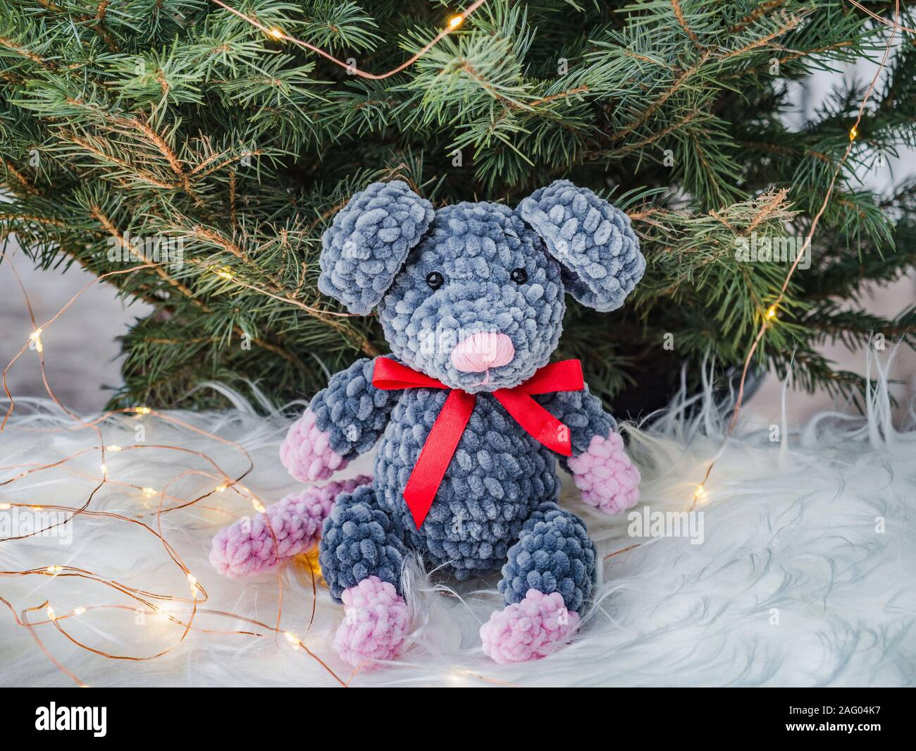 Plush toy, Christmas tree and Christmas decorations Stock Photo